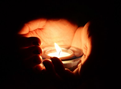 candle-lighting-in-hands-390×285[1]